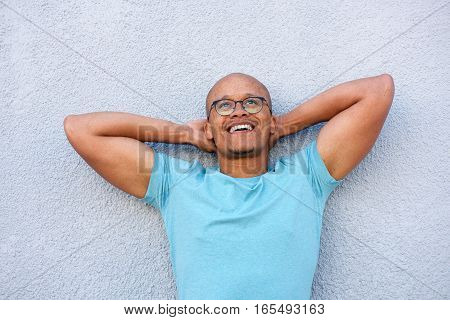 African American Man Smiling With Glasses Looking Up In Contemplation