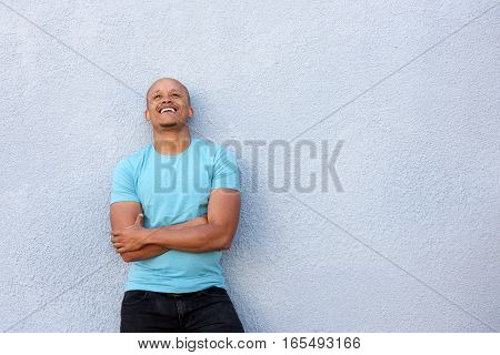 African American Guy Laughing With Arms Crossed Looking Up
