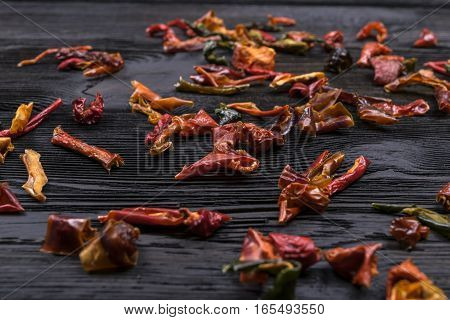 dark wooden texture background with dried pepper, close uo