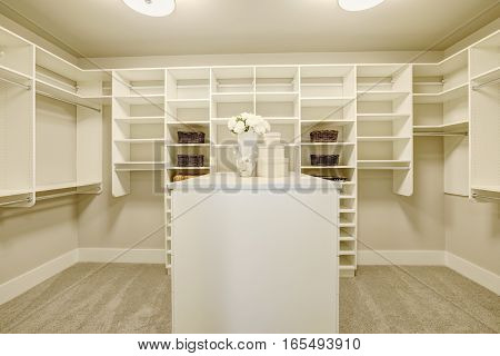 Huge Walk-in Closet With Shelves, Drawers And Shoe Racks.