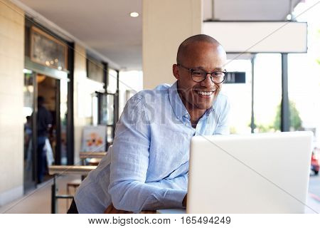 Handsome African Businessman Working With Laptop