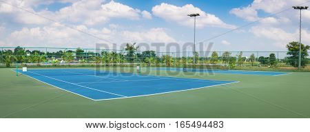 Tennis Court at tennis club panorama. Tennis Court. Tennis Court game. Tennis Court sport. Tennis Court outdoor. Tennis green Court.
