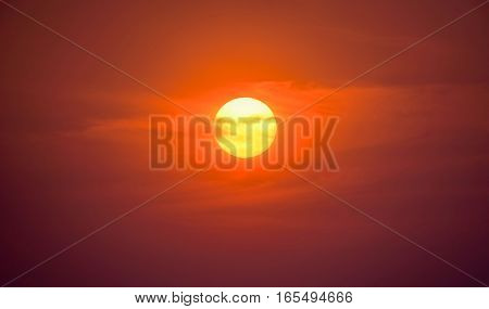 Summer sunset. The setting sun in a cloudy sky background. Natural Sunset Sunrise Over Field Or Meadow. Bright Dramatic Sky And Dark Ground. Countryside Landscape Under Scenic Colorful Sky At Sunset Dawn Sunrise. Sun Over Skyline, Horizon. Warm Colours.