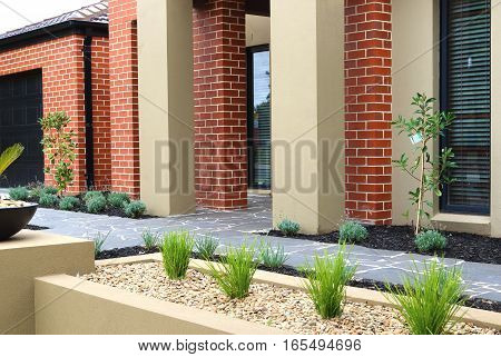 Combinations of plants paving and rocks modern architecture concept