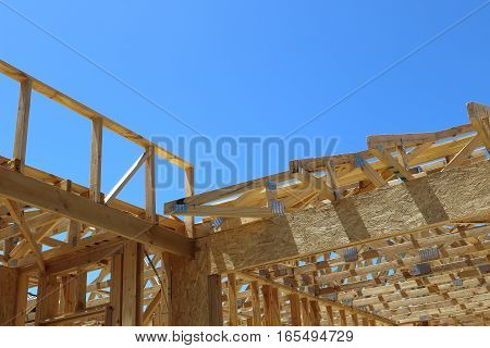 New framing construction of residential house over blue sky with copy space