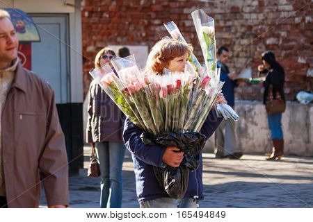 MOSCOW RUSSIA - March 25 2007. Woman selling roses on Arbat street. Sunny spring day in historic center of city.