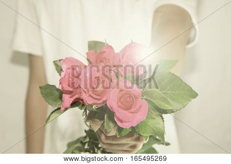 The man consign the roses to you with flare filter style