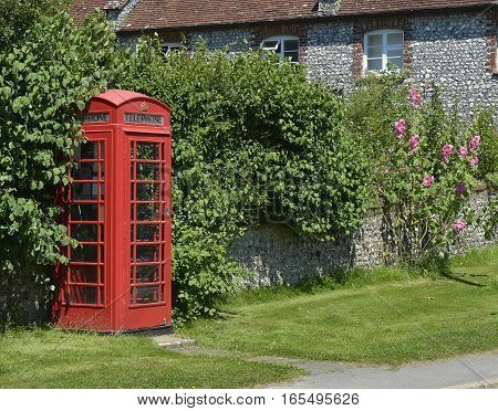 British red telephone box in the village of East Dean near Chichester West Sussex England