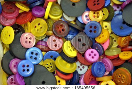 Collection of colorful assorted spare clothes buttons.