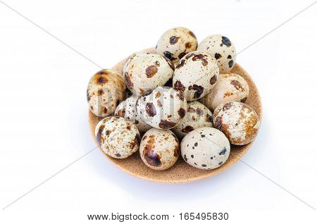 quail eggs on a plate isolated on white background