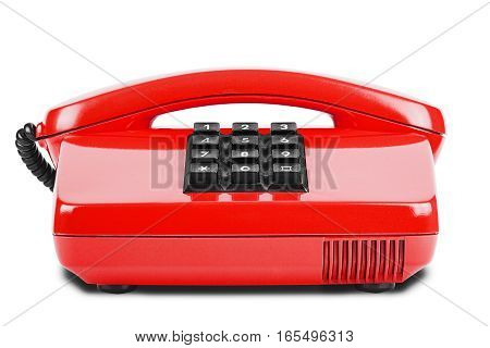Old red phone with shadow on a isolated white background