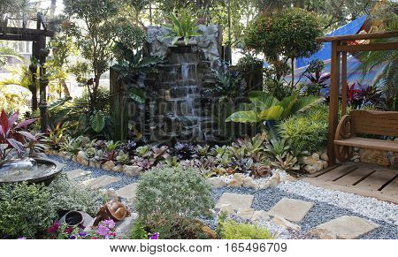 Beautiful well arranged, colorful backyard garden complemented with stones