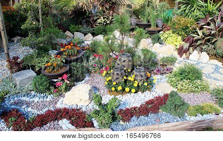 simple garden made beautiful by adding colored stones
