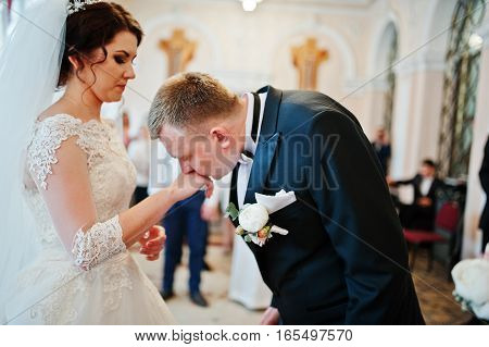 Groom Kissed Hand Of Bride At Hall Of Registration Their Marriage.