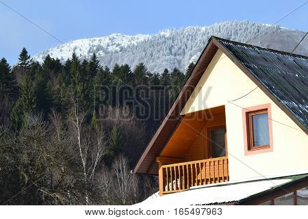 Winter in the Carpathian Mountains. Here the peaks of mountains Ciucas with pine forests and tourist resort