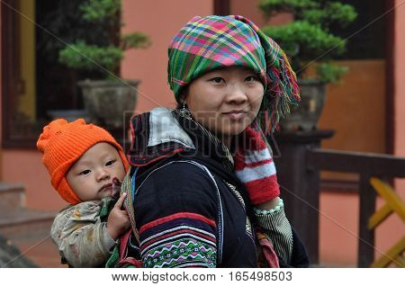 Vietnamese Hmong Woman Carrying Her Child