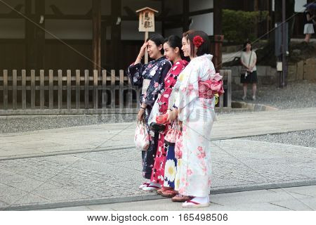 KyotoJapan-June 26Women's kimonos post and smile for photo within Fushimi Inari shrine on June 262016 in KyotoJapan. Selective focus at wowan.