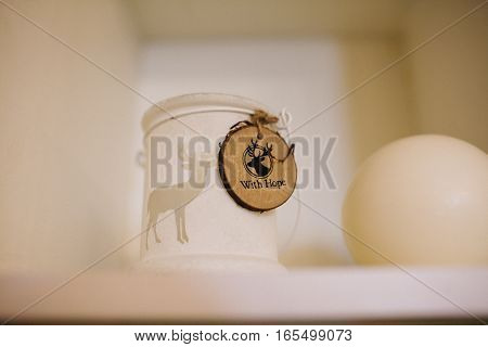Wooden ornament with deer on a mug