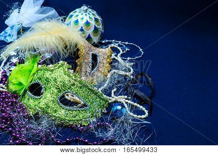 Theatrical masks with ornaments a tinsel against a dark background