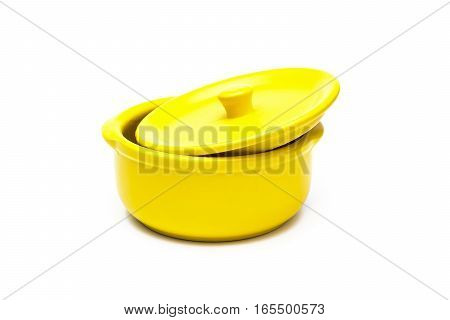 Yellow ceramic pot on white background .