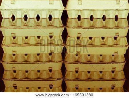 Carton Egg Boxes On A  Black Reflective Surface
