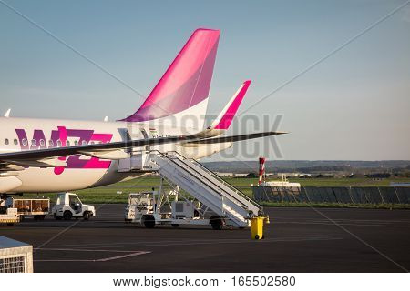 Sofia Bulgaria - APRIL 15 2015: Airplane is near the terminal gate ready for takeoff. Crew is preparing the plane for flight. Wizzair is a rapidly growing low-cost carrier based in Hungary.