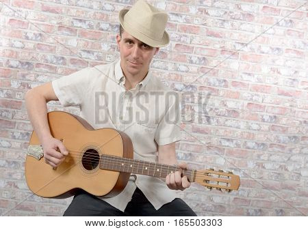 young man with an acoustic guitar in his hands