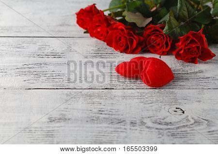 Few Red Roses On White Table