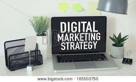 Digital marketing business strategy concept in office with laptop on desk