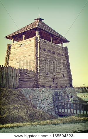 The historical complex Zaporizhzhya Sich on the island of Khortytsya Ukraine. Toned photo in a retro style. The entry tower.