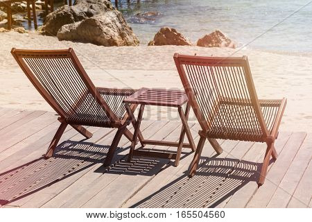 Two sitting place and table in a tropical beach