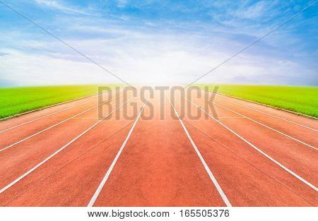 Running track in stadium. Running track on blue sky. Running track concept. Running track field. Running track sport. Running track sun.