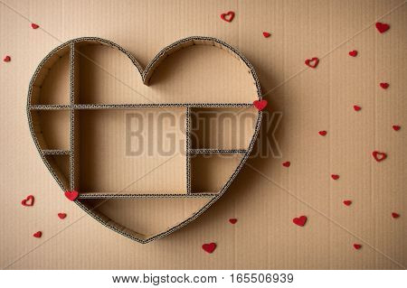 Heart-shaped shadow box hand-made of corrugated on cardboard background
