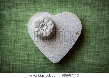 Heart and flowers made of paper mache on a fabric background to be used for crafts