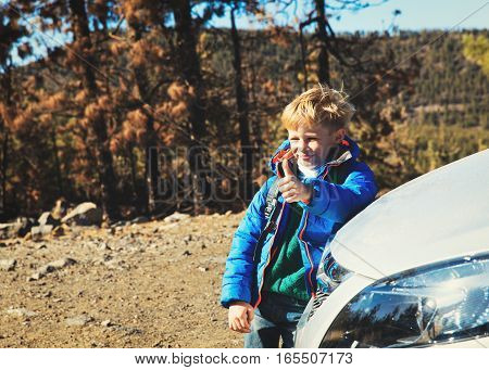 little boy with backpack loves travel by car in nature, kids travel concept