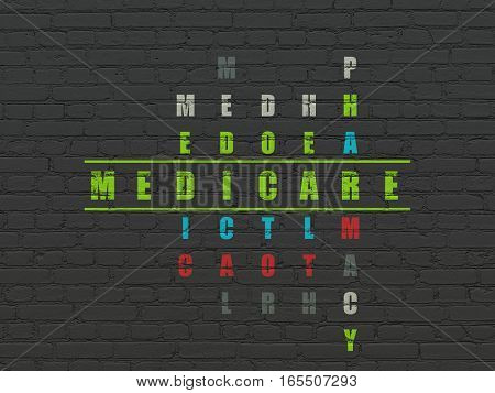 Health concept: Painted green word Medicare in solving Crossword Puzzle
