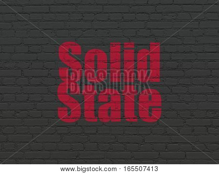 Science concept: Painted red text Solid State on Black Brick wall background