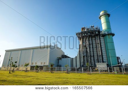 Combine Cycle Power Plant With Green Field And Clear Sky