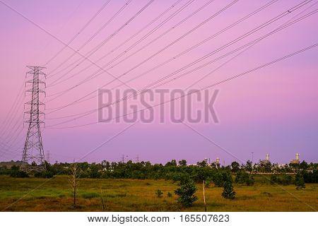 High Voltage Pole Against Twilight Sky