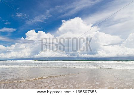 Waves sand beach and clouds sunny day on playa santa teresa costa rica