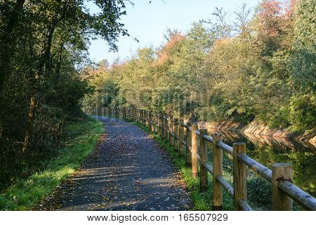 Lombardy Italy: bicycle track along the Villoresi canal at fall (october)