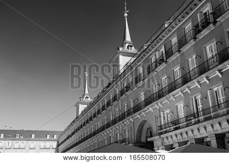 Madrid (Spain): facade of historic buildings in Plaza Mayor the main square of the city. Black and white