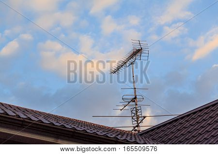 Rooftop television Yagi-Uda antennas on sky background
