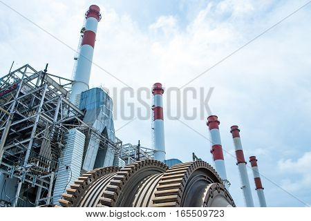 Rotator against thermal power plant with clear sky