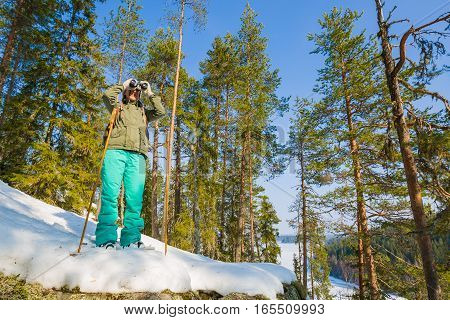 Young Beautiful Woman With Snowshoes Chill Out In The Forest