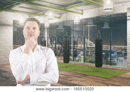 Businessman Standing In The Gym