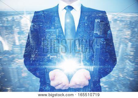 Businessman Holding Light