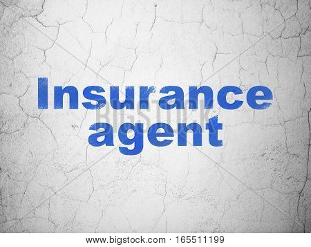 Insurance concept: Blue Insurance Agent on textured concrete wall background