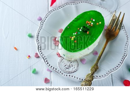 delicious piece of cheesecake on white wooden background