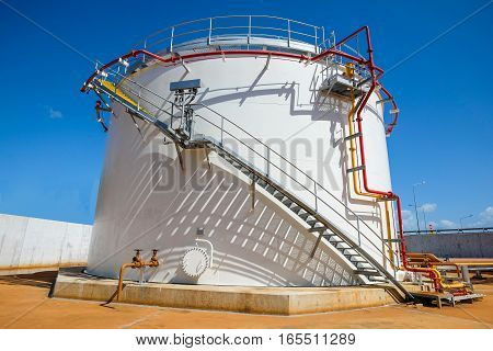 Old fuel oil storage tank in power plant or refinery with fire protection system